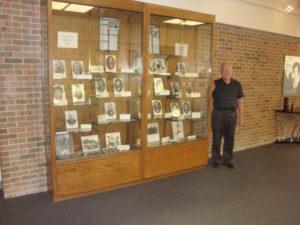 Curator Jim Marckel is standing beside the Museum Hall Display